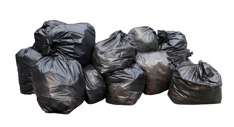waste, black garbage bags plastic pile stack isolated on white background, lots pile of garbage black bags stack